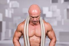 Imagen compuesta del hombre calvo con la cuerda alrededor del cuello Fotografía de archivo