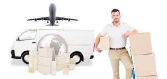 Imagen compuesta del hombre de entrega con la carretilla de cajas Fotos de archivo libres de regalías