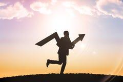 Imagen compuesta del hombre de negocios con la flecha Foto de archivo libre de regalías