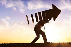 Imagen compuesta del hombre de negocios con la flecha Imagen de archivo libre de regalías