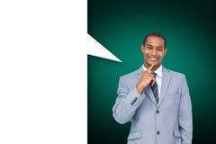 Imagen compuesta del hombre de negocios de pensamiento con la burbuja del discurso Foto de archivo libre de regalías