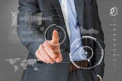 Imagen compuesta del hombre de negocios en traje gris que señala en el interfaz Imágenes de archivo libres de regalías