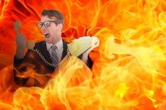 Imagen compuesta del hombre de negocios geeky que grita en el teléfono Imágenes de archivo libres de regalías