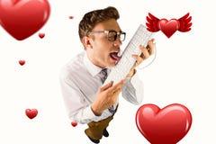 Imagen compuesta del hombre de negocios geeky que lame su teclado Imagen de archivo libre de regalías