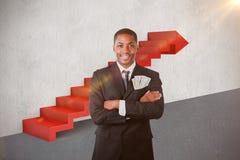Imagen compuesta del hombre de negocios hermoso con los dólares en un bolsillo 3d Imágenes de archivo libres de regalías