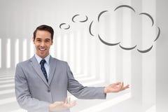 Imagen compuesta del hombre de negocios joven que presenta algo con la burbuja del pensamiento Imagen de archivo libre de regalías