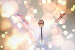 Imagen compuesta del hombre de negocios que anima con sus brazos aumentados para arriba Fotografía de archivo libre de regalías