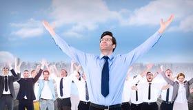 Imagen compuesta del hombre de negocios que anima con sus brazos aumentados para arriba Foto de archivo