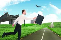 Imagen compuesta del hombre de negocios que camina con su cartera Foto de archivo libre de regalías