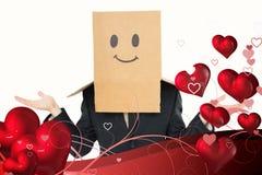 Imagen compuesta del hombre de negocios que encoge con la caja en la cabeza Fotos de archivo libres de regalías