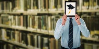 Imagen compuesta del hombre de negocios que sostiene la tableta digital delante de la cara Imagen de archivo