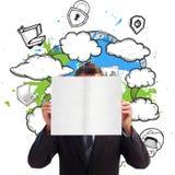Imagen compuesta del hombre de negocios que sostiene una tarjeta blanca delante de su cara Imagen de archivo