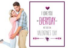 Imagen compuesta del hombre hermoso que abraza a su novia Foto de archivo libre de regalías