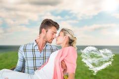 Imagen compuesta del hombre hermoso que coge y que abraza a su novia Fotos de archivo