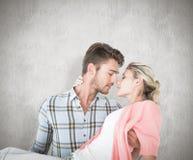 Imagen compuesta del hombre hermoso que coge y que abraza a su novia Fotografía de archivo libre de regalías
