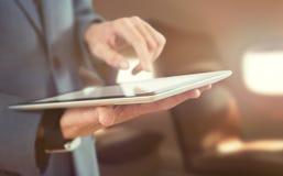 Imagen compuesta del midsection del hombre de negocios usando la tecnología inalámbrica Foto de archivo