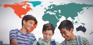 Imagen compuesta del muchacho con los amigos que usan la tableta digital en banco Imagen de archivo