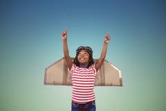 Imagen compuesta del muchacho sonriente que finge ser piloto Fotografía de archivo
