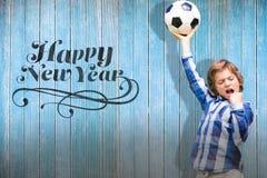 Imagen compuesta del niño con el balón de fútbol Imágenes de archivo libres de regalías
