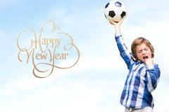 Imagen compuesta del niño con el balón de fútbol Imagen de archivo libre de regalías