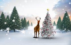 Imagen compuesta del árbol de navidad y del reno Fotografía de archivo libre de regalías