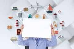 Imagen compuesta del retrato de un hombre de negocios que oculta su cara detrás de un panel en blanco Fotos de archivo