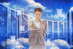Imagen compuesta del retrato de una empresaria seria que señala en el espectador Foto de archivo libre de regalías