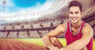 Imagen compuesta del retrato del atleta feliz que se sienta en el fondo blanco Fotografía de archivo libre de regalías