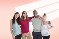Imagen compuesta del retrato del equipo sonriente del negocio con los brazos alrededor fotografía de archivo libre de regalías