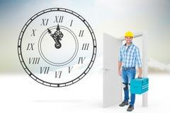 Imagen compuesta del retrato integral del reparador con la caja de herramientas Imagen de archivo libre de regalías