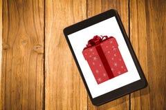 Imagen compuesta del rojo y de la caja de regalo de la plata Imágenes de archivo libres de regalías