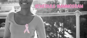 Imagen compuesta del texto del mamograma del horario con la cinta de la conciencia del cáncer de pecho imagenes de archivo