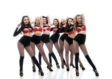 Imagen de bailarines agraciados en trajes eróticos Foto de archivo libre de regalías
