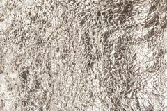 Imagen de fondo abstracta arrugada de la hoja de plata fotografía de archivo libre de regalías