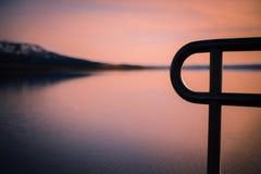 Imagen de fondo del extremo del embarcadero en la puesta del sol fotografía de archivo libre de regalías