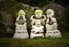 Imagen de la acción de la figurilla de Buda Imagen de archivo libre de regalías