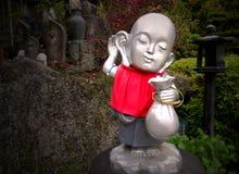 Imagen de la acción de la figurilla de Buda Foto de archivo libre de regalías