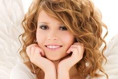 Imagen de la muchacha adolescente feliz del ángel Fotos de archivo