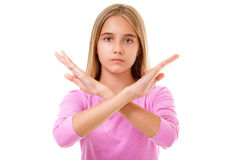 Imagen de la muchacha adolescente joven que hace gesto de la parada Aislado Imagen de archivo libre de regalías