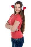 Imagen de la muchacha en auriculares de Navidad con los brazos cruzados Imagen de archivo libre de regalías