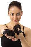 Imagen de la muchacha gris-observada bonita en guantes del entrenamiento Imagenes de archivo