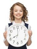 Muchacha con el reloj grande Fotos de archivo