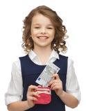Muchacha con los billetes del monedero y Fotografía de archivo