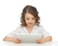Muchacha con PC de la tableta Foto de archivo