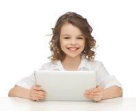 Muchacha con PC de la tableta Imagen de archivo