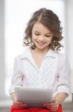 Muchacha con PC de la tableta Fotografía de archivo