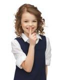 muchacha Pre-adolescente que muestra gesto del silencio Foto de archivo libre de regalías