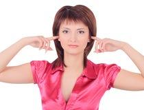 Imagen de la mujer con las manos en los oídos Imagen de archivo