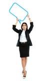 Imagen de la mujer de negocios integral que lleva a cabo la burbuja en blanco del texto Fotografía de archivo libre de regalías