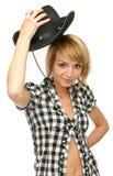 Chica joven con el sombrero de vaquero Fotos de archivo libres de regalías
